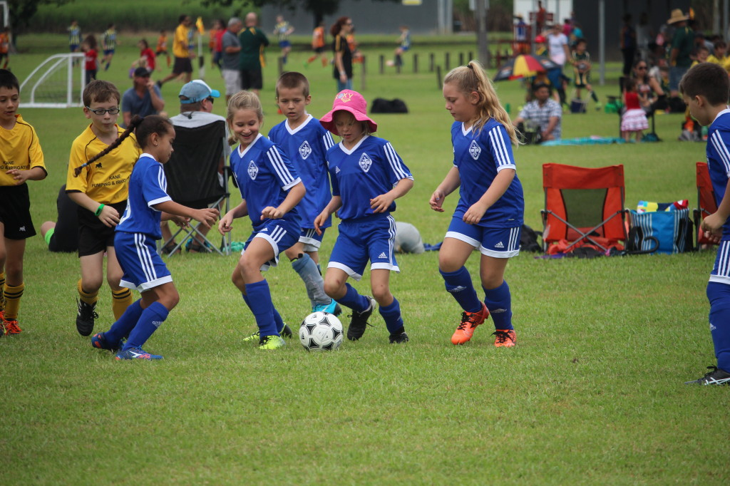 Under 9 girls taking control of the ball.